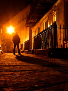 Simon walks down a road