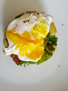 Poached egg on bubble & squeak stack.