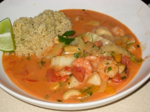 Seafood in coconut and tomato with quinoa