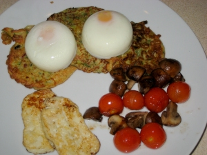 Courgette fritters, poached eggs, halloumi and veggies