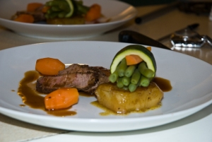 Canon of lamb with porcini powder with fondant potatoes and veggies