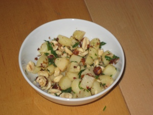 Stirfried water chestnuts with garlic & chilli & hazelnuts