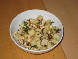 Stirfried water chestnuts with garlic & chilli & hazelnuts