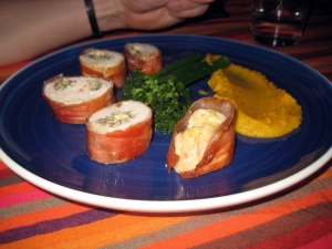Chicken stuffed with mushroom and camembert, wrapped in parma ham. Butternut and tenderstem broc