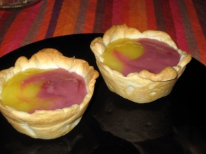 Lemon and Raspberry Curds in tarts