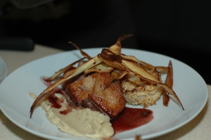 Tea-smoked duck breast with a celeriac rosti, white bean and roasted garlic purée, parsnip crisps and a juniper jus