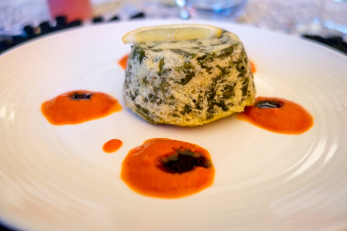 Spinach Timbale with red pepper sauce