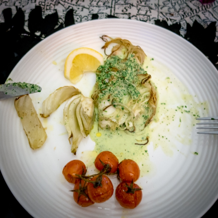 Lemon sole wrapped in spiralised potato with roasted fennel and tomatoes