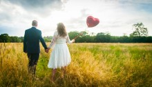 If you've got a field, then photograph the couple in it. With a balloon.